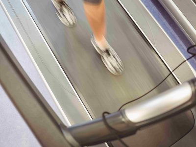 Fit woman jogging on treadmill at the gym
